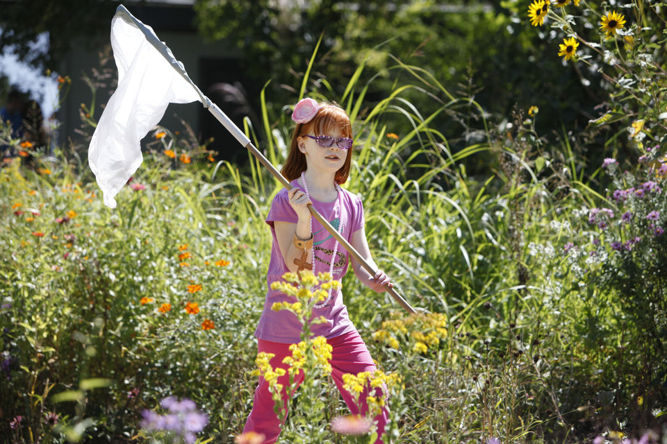 Eight-year-old Megan Huffman searches for monarch butterflies during a monarch tagging event at the Oklahoma City Zoo in Oklahoma City, OK, Monday, Sept. 26, 2011. By Paul Hellstern, The Oklahoman