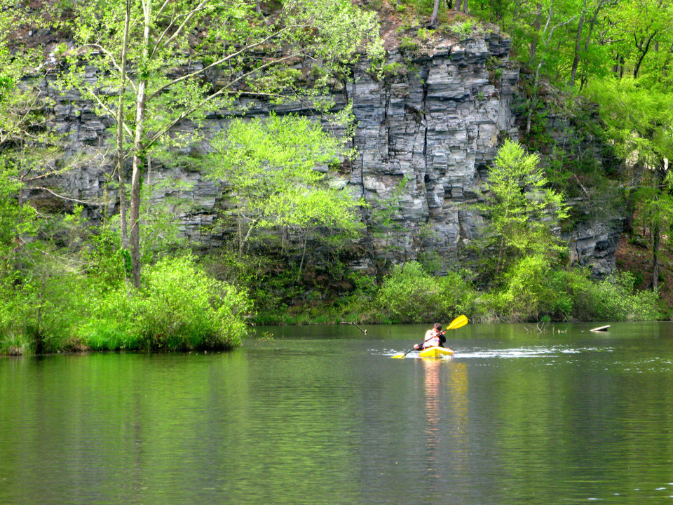 Photo - Bennett Brinkman, 14, kayaks by the cliffs on the Lower Mountain Fork River in Beavers Bend State Park. PHOTO BY LILLIE-BETH BRINKMAN, THE OKLAHOMAN