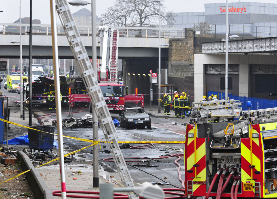 Photo - Debris lies on the ground after a helicopter crashed into a construction crane on top of St George's Wharf tower building, in London, Wednesday Jan. 16, 2013. Police say two people were killed when a helicopter crashed during rush hour in central London after apparently hitting a construction crane on top of a building. (AP Photo/Vince Pol)