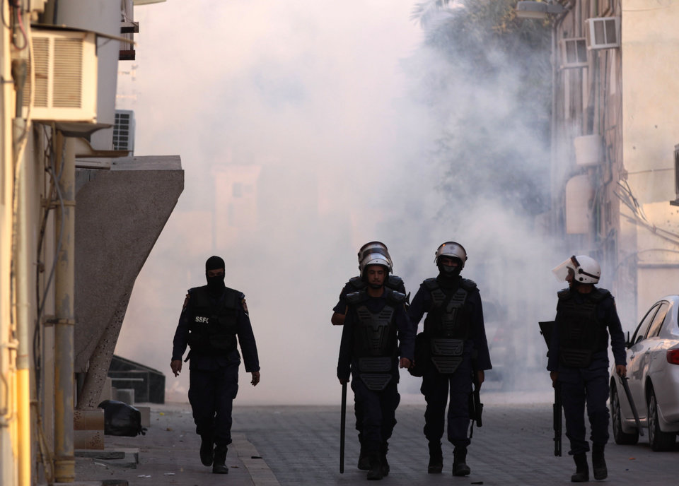 Photo -   Riot police pull back after firing tear gas and stun grenades at a group of Bahraini women protesting against the government in Buri, Bahrain, southwest of the capital of Manama, on Wednesday, June 27, 2012. Prominent Bahraini human rights activist Zainab al-Khawaja was shot in the leg with a tear gas canister and taken to a hospital by another activist. (AP Photo/Hasan Jamali)