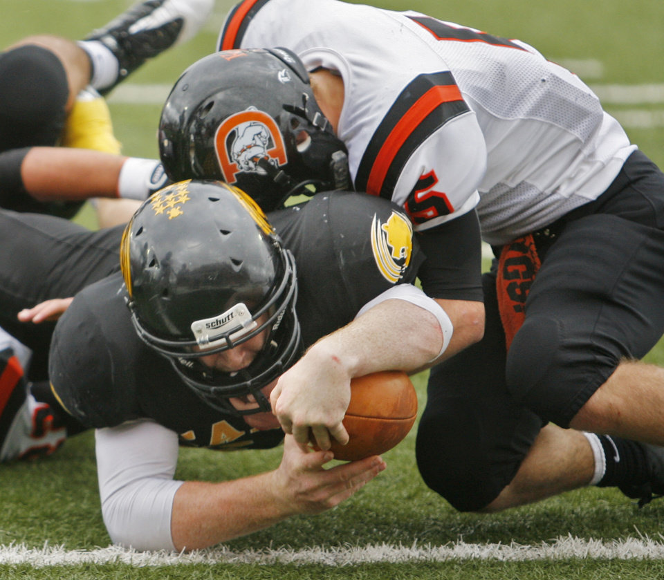 Photo - Caddo's quarterback Dillon Proctor (20) scored on a keeper as the Caddo Bruins play the Davenport Bulldogs in the Class B State Championship high school football game on Saturday, Dec. 3, 2011, in Newcastle, Okla.   Photo by Steve Sisney, The Oklahoman