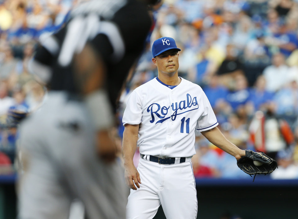 Kansas City Royals starting pitcher Jeremy Guthrie (11) gets a new ball after walking in Chicago White Sox's Alexei Ramirez during the first inning of a baseball game at Kauffman Stadium in Kansas City, Mo., Friday, June 21, 2013. (AP Photo/Orlin Wagner)