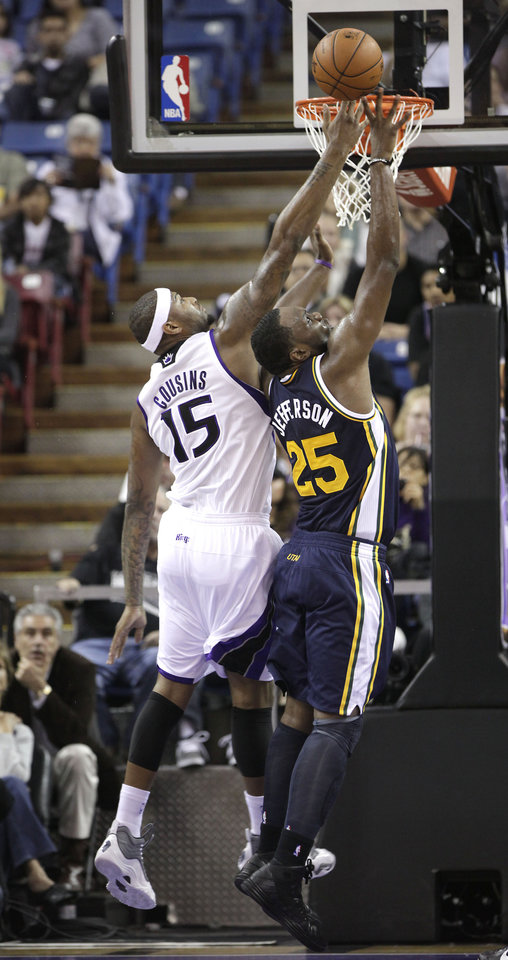 Photo -   Sacramento Kings center DeMarcus Cousins, left, vies for a rebound with Utah Jazz center Al Jefferson during the first half of an NBA basketball game in Sacramento, Calif., Saturday, Nov. 24, 2012.(AP Photo/Rich Pedroncelli)