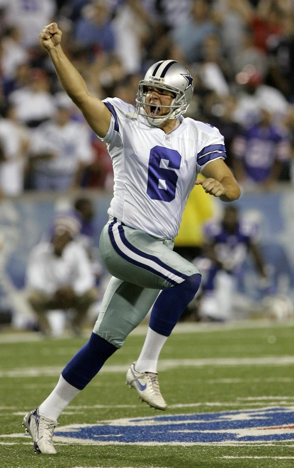 Photo - Dallas Cowboys kicker Nick Folk celebrates his game winning field goal as time runs out in the NFL football game against the Buffalo Bills at Ralph Wilson Stadium in Orchard Park, N.Y., Monday, Oct. 8, 2007. The Cowboys won 25-24. (AP Photo/David Duprey) ORG XMIT: NYDD110