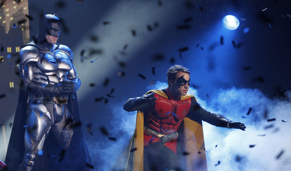 Nick Court, who plays Batman, and Michael Pickering who plays Robin, perform on stage to launch the Batman Live Tour in central London, Tuesday 12 April 2011, which tours arenas across the UK and Europe beginning in Summer 2011, and arrives in North America in August 2012. Combining acrobatics, stunt work and illusions, the adventures of Batman and Robin are brought to life on stage for the first time in the characters history.(AP Photo/Joel Ryan)