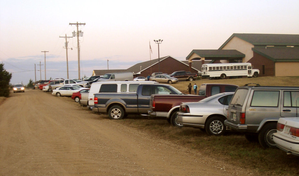 Photo - Voter's cars line the road at a polling place in Bethel Acres early Tuesday, Nov. 4, 2008. PHOTO BY RYAN SHARP, THE OKLAHOMAN.