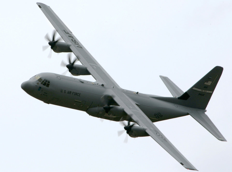 Photo - FILE - This June 20, 2007, file photo shows a C-130-J transport aircraft over Little Rock Air Force Base in Jacksonville, Ark. President Barack Obama authorized U.S. airstrikes in northern Iraq, Thursday, Aug. 7, 2014, warning they would be launched if needed to defend Americans from advancing Islamic militants and protect civilians under siege. Obama said American military planes already had carried out airdrops of humanitarian aid to tens of thousands of Iraqi religious minorities surrounded by militants and desperately in need of food and water. The Pentagon said the airdrops were performed by one C-17 and two C-130 cargo aircraft that together delivered a total of 72 bundles of food and water. They were escorted by two F/A-18 fighters. (AP Photo/Danny Johnston)