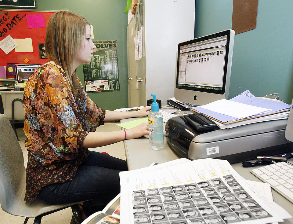 Photo - Yearbook staffer McKenna Howard does some work on the Santa Fe High School yearbook.  Photo by Paul Hellstern, The Oklahoman