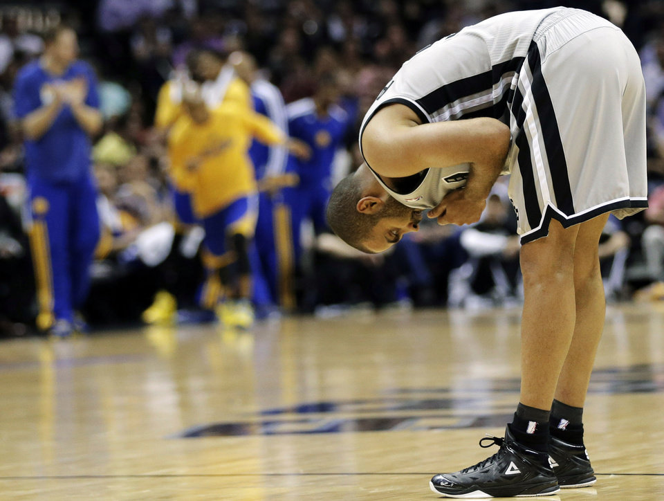 Photo - San Antonio Spurs' Tony Parker (9), of France, catches his breath during the second half in Game 2 of their Western Conference semifinal NBA basketball playoff series against the Golden State Warriors, Wednesday, May 8, 2013, in San Antonio. (AP Photo/Eric Gay)