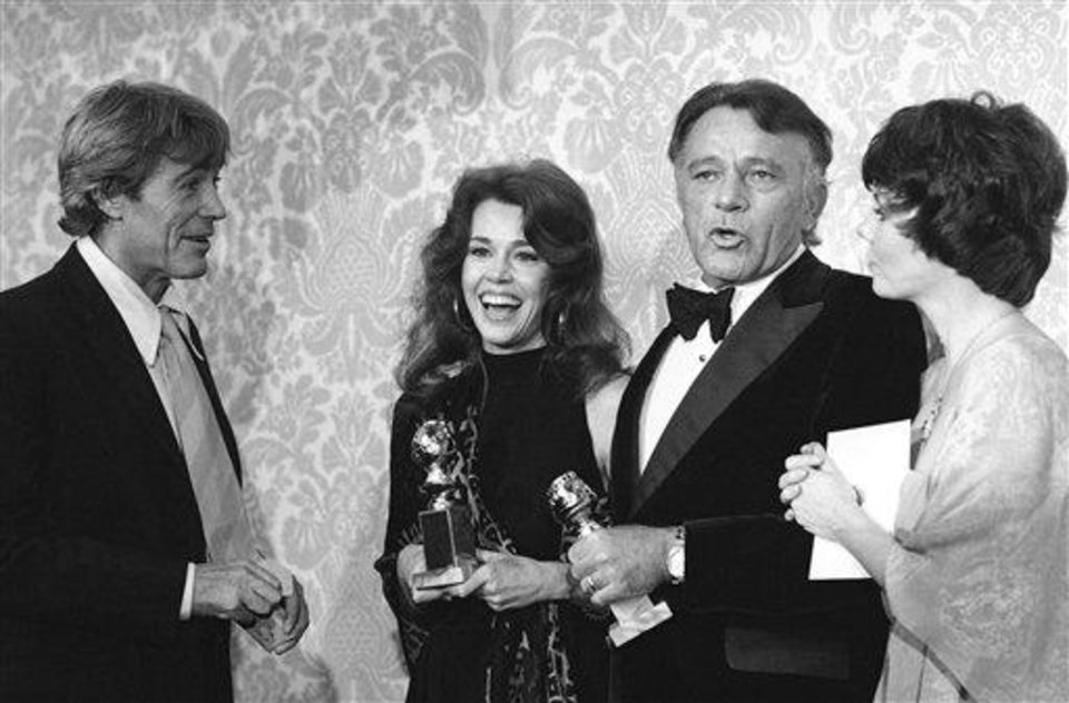 Actress Jane Fonda And Actor Richard Burton hold Golden Globes Awarded them Jan 30,1978 by The Hollywood Foreign Press Association. They were named best dramatic motion picture actor and actress of 1977. Other man and woman not identified. (AP Photo/RRS)