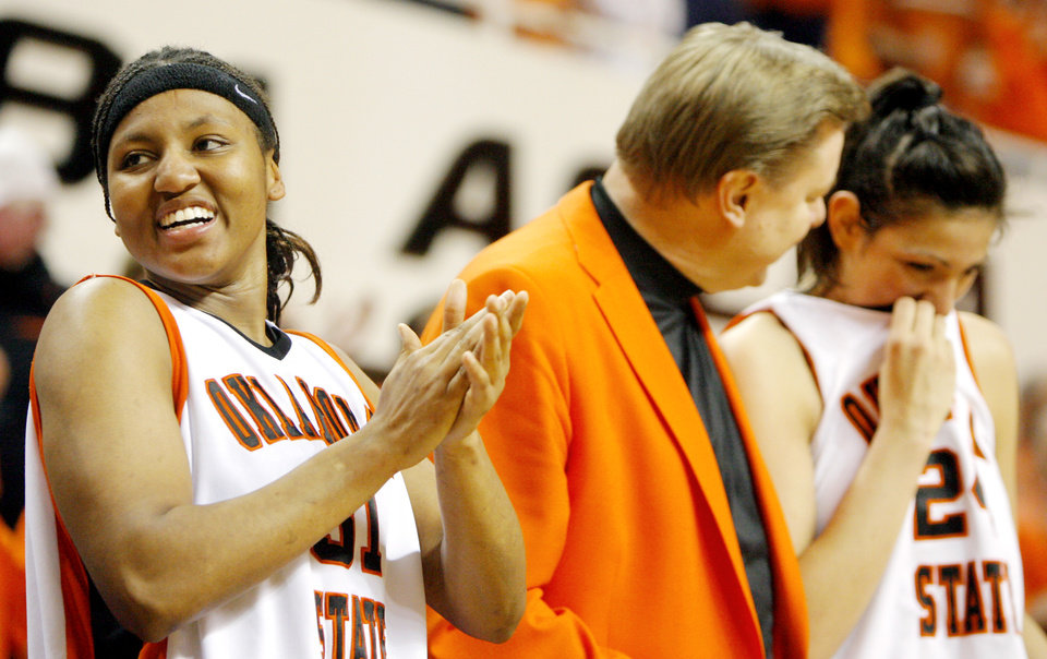 Photo - OSU seniors Danielle Green, left, and Maria Cordero stand with head coach Kurt Budke after being recognized during Senior Night following the women's college basketball game between Oklahoma State University and Texas Tech University at Gallagher-Iba Arena in Stillwater, Okla., Saturday, March 1, 2008. BY MATT STRASEN, THE OKLAHOMAN