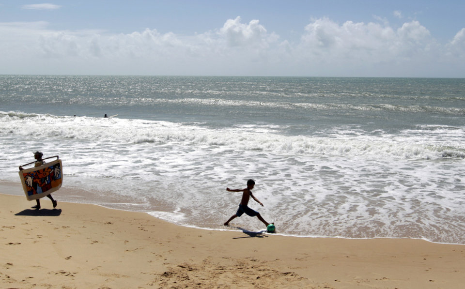 Photo - A boy plays soccer on Ponta Negra beach in Natal, Brazil, Wednesday, June 18, 2014.  Natal is one of the host cities for the World Cup soccer tournament. (AP Photo/Shuji Kajiyama)