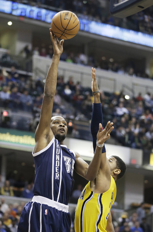 Oklahoma City Thunder's Kevin Durant, left, shoots over Indiana Pacers' Paul George during the first half of an NBA basketball game on Friday, April 5, 2013, in Indianapolis. (AP Photo/Darron Cummings)  ORG XMIT: NAF104