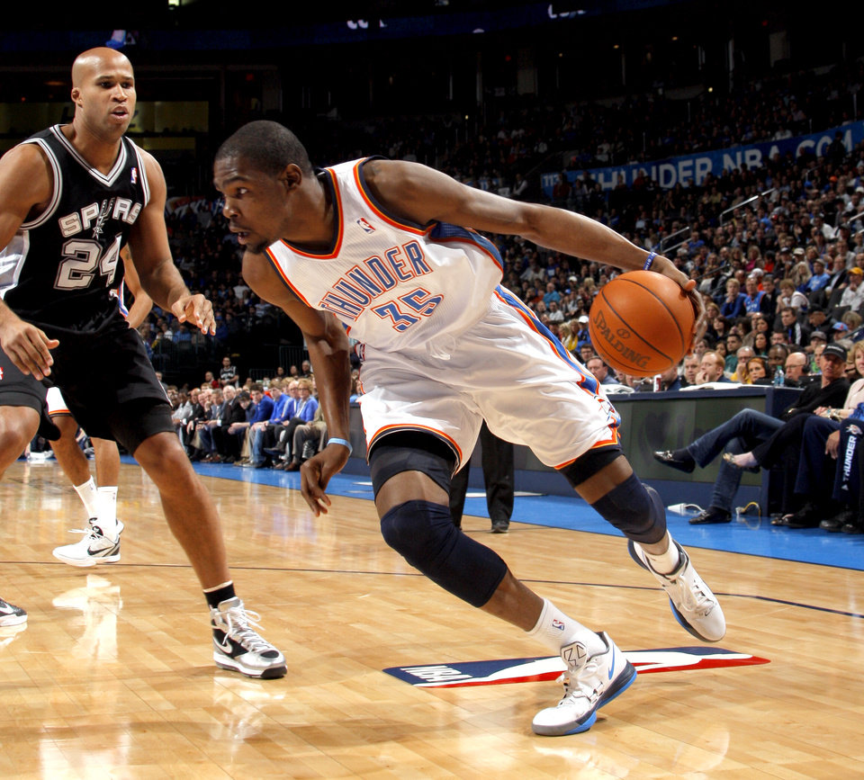 Photo - Oklahoma City Thunder's Kevin Durant (35) drives past San Antonio Spurs' Richard Jefferson (24) during the the NBA basketball game between the Oklahoma City Thunder and the San Antonio Spurs at the Chesapeake Energy Arena in Oklahoma City, Sunday, Jan. 8, 2012. Photo by Sarah Phipps, The Oklahoman