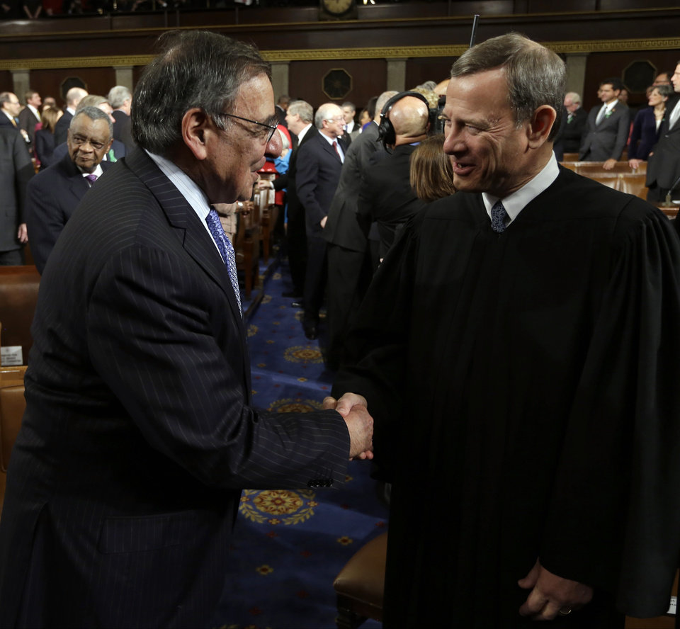 Outgoing Defense Secretary Leon Panetta, left, shakes hands with Chief Justice John Roberts before President Barack Obama's State of the Union address during a joint session of Congress on Capitol Hill in Washington, Tuesday Feb. 12, 2013. (AP Photo/Charles Dharapak Pool) ORG XMIT: CAP507