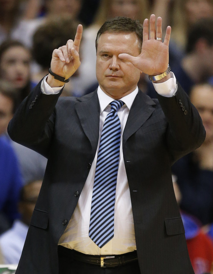 Photo - Kansas head coach Bill Self calls a play during the first half of an NCAA college basketball game against Texas in Lawrence, Kan., Saturday, Feb. 22, 2014. (AP Photo/Orlin Wagner)