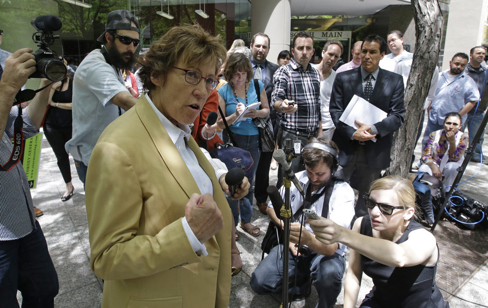Photo - Peggy Tomsic, attorney for the three couples who brought the lawsuit against the Utah's gay marriage ban, speaks during a news conference in Salt Lake City on Wednesday, June 25, 2014. On Wednesday, a federal appeals court ruled that states must allow gay couples to marry, finding the Constitution protects same-sex relationships. The decision from a three-judge panel in Denver upheld a lower court ruling that struck down Utah's gay marriage ban. (AP Photo/Rick Bowmer)