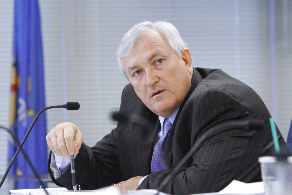 Photo - State Board Member Leo J. (Lee) Baxter at a Board of Education meeting deciding to grant high school diplomas to several Oklahoma students who failed state-mandated end-of-instuction exams, Tuesday, June 5, 2012.  Photo By David McDaniel/The Oklahoman