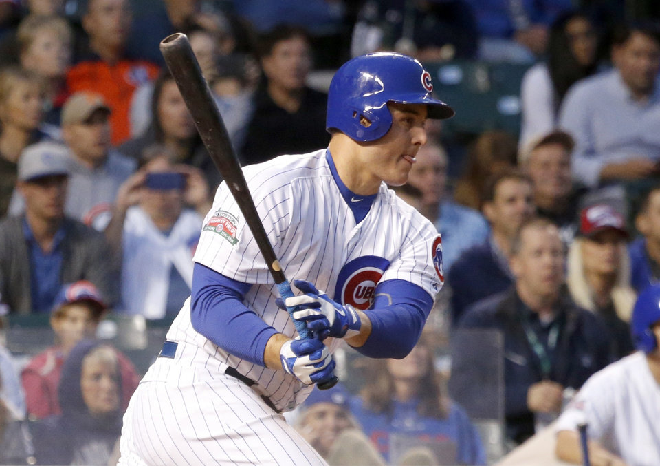Photo - Chicago Cubs' Anthony Rizzo grounds out to Colorado Rockies second baseman DJ LeMahieu during the fourth inning of a baseball game Monday, July 28, 2014, in Chicago. Emilio Bonifacio scored on the play (AP Photo/Charles Rex Arbogast)