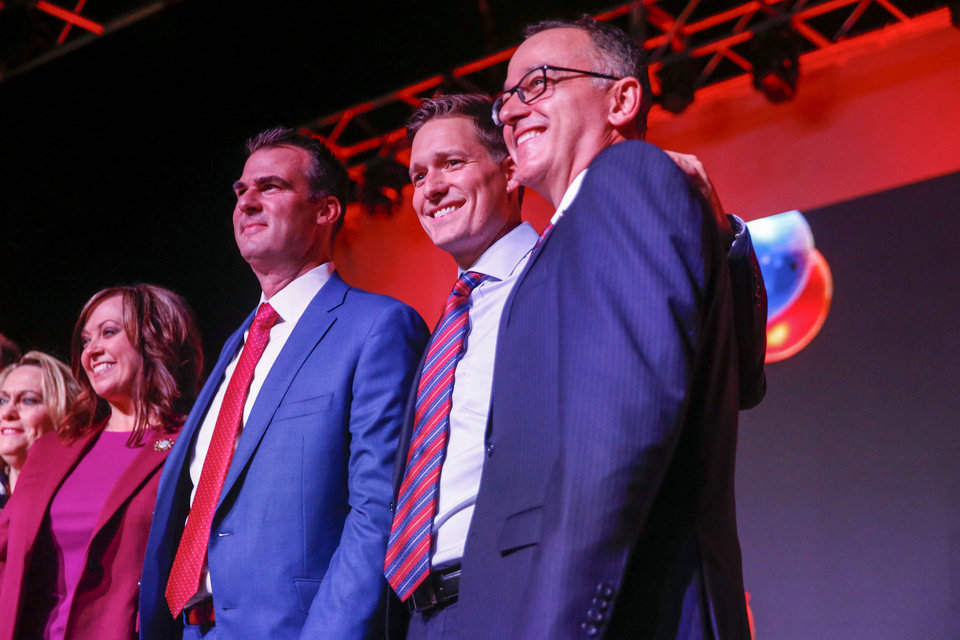 Photo - Newly Elected Governor Kevin Stitt, Lieutenant Governor Matt Pinnell, and Treasurer Randy McDaniel pose for a photo during a Republican watch party at the Bricktown Event Center in Oklahoma City on Tuesday, November 06, 2018. [IAN MAULE/Tulsa World file]
