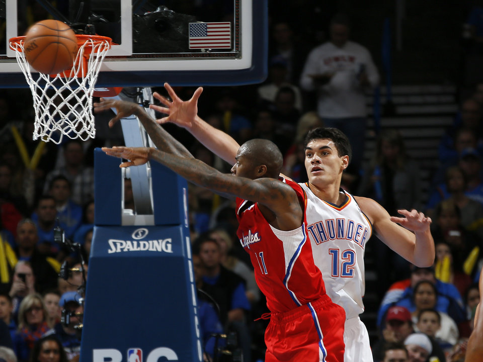 Oklahoma City's Steven Adams (12) defends Los Angeles Clippers' Jamal Crawford (11)  during an NBA basketball game between the Oklahoma City Thunder and the Los Angeles Clippers at Chesapeake Energey Arena in Oklahoma City, Thursday, Nov. 21, 2013. Photo by Bryan Terry, The Oklahoman