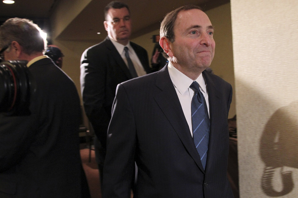 Photo - NHL commissioner Gary Bettman leaves the room after speaking to reporters after an NHL Board of Governors meeting, Wednesday, Dec. 5, 2012 in New York.  The league and the NHL Players' Association have cleared their schedules with progress being made in collective bargaining talks. (AP Photo/Mary Altaffer)