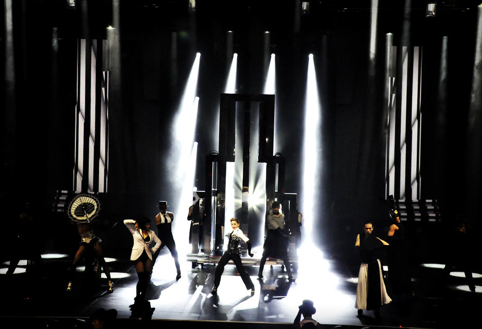 Photo -   In this photo provided by Guy Oseary, Madonna performs on stage with dancers during her MDNA concert at Olympia Hall in Paris on Thursday, July 26, 2012. (AP Photo/Guy Oseary)