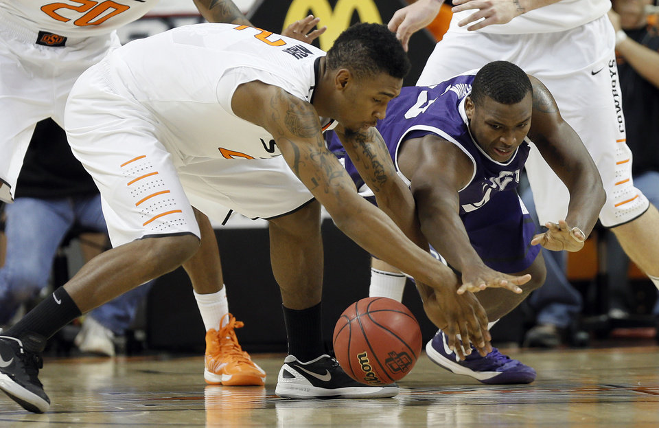 Oklahoma State's Le'Bryan Nash (2) and TCU's Devonta Abron (23) go after a loose ball during the college basketball game between Oklahoma State University Cowboys (OSU) and Texas Christian University Horned Frogs (TCU) at Gallagher-Iba Arena on Wednesday Jan. 9, 2013, in Stillwater, Okla. 