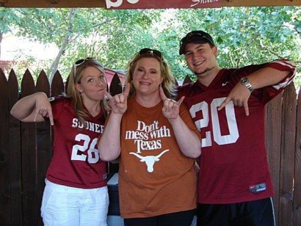 "My ""second family"" are Sooner fans, and I get teased good-naturedly about being from Texas...Every year we have a GREAT time watching ""the big game"" together!  They also think it's funny that I (The Texas fan) am the ONLY one who calls it ""The Red River Shootout"".   People in photo: Tavia Redburn, Victoria Jimenez, Philip Redburn<br/><b>Community Photo By:</b> Donna Atchley<br/><b>Submitted By:</b> Victoria, Harrah"