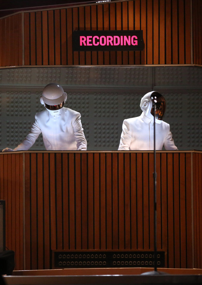 Thomas Bangalter, left, and Guy-Manuel de Homem-Christo of Daft Punk perform at the 56th annual Grammy Awards at Staples Center on Sunday, Jan. 26, 2014, in Los Angeles. (Photo by Matt Sayles/Invision/AP)