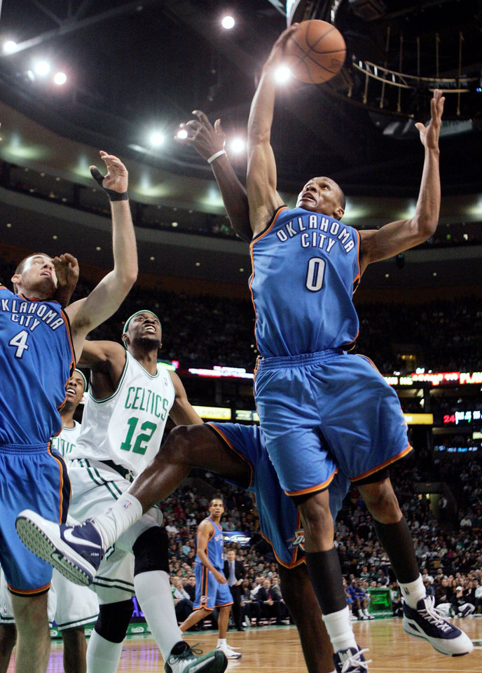 Photo - Oklahoma City Thunder's Russell Westbrook (0) grabs a rebound in front of Boston Celtics' Bill Walker (12) in the third quarter of an NBA basketball game, Sunday, March 29, 2009, in Boston. The Celtics won 103-84. (AP Photo/Michael Dwyer) ORG XMIT: BXG107