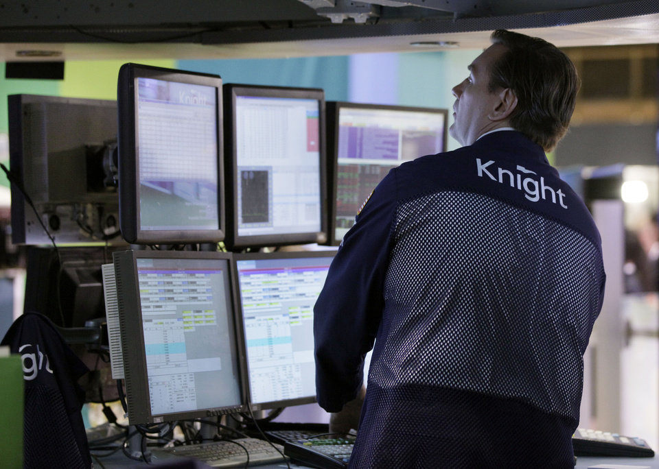 Photo -   Specialist Patrick King works at his post on the floor of the New York Stock Exchange Monday, June 18, 2012. U.S. stocks are falling after the opening bell as Europe's debt crisis roils markets despite the victory of a pro-Europe party in Greek elections. (AP Photo/Richard Drew)