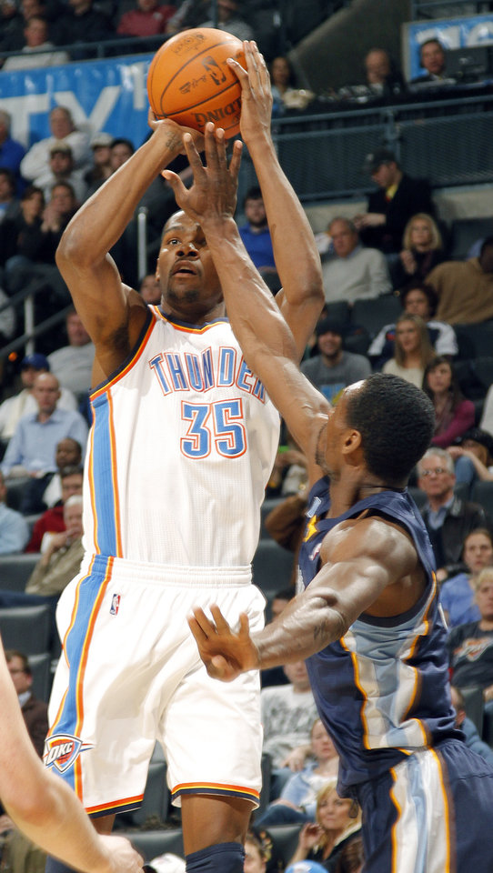Photo - The Thunder's Kevin Durant (35) puts up a shot over Memphis' Tony Allen (9) during the NBA basketball game between the Oklahoma City Thunder and the Memphis Grizzlies at the Oklahoma City Arena on Tuesday, Feb. 8, 2011, Oklahoma City, Okla.Photo by Chris Landsberger, The Oklahoman