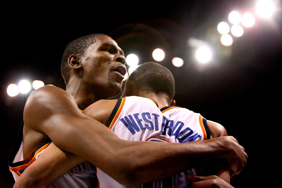CELEBRATION: Oklahoma City's Kevin Durant, left, and Russell Westbrook celebrate during the NBA basketball game between the Oklahoma City Thunder and the Utah Jazz, Sunday, March 15, 2010, at the Ford Center in Oklahoma City. Photo by Sarah Phipps, The Oklahoman  ORG XMIT: KOD