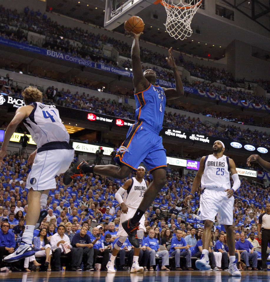 Photo - Oklahoma City's Nazr Mohammed (8) goes to the basket during Game 4 of the first round in the NBA playoffs between the Oklahoma City Thunder and the Dallas Mavericks at American Airlines Center in Dallas, Saturday, May 5, 2012. Oklahoma City won 103-97.  Photo by Bryan Terry, The Oklahoman