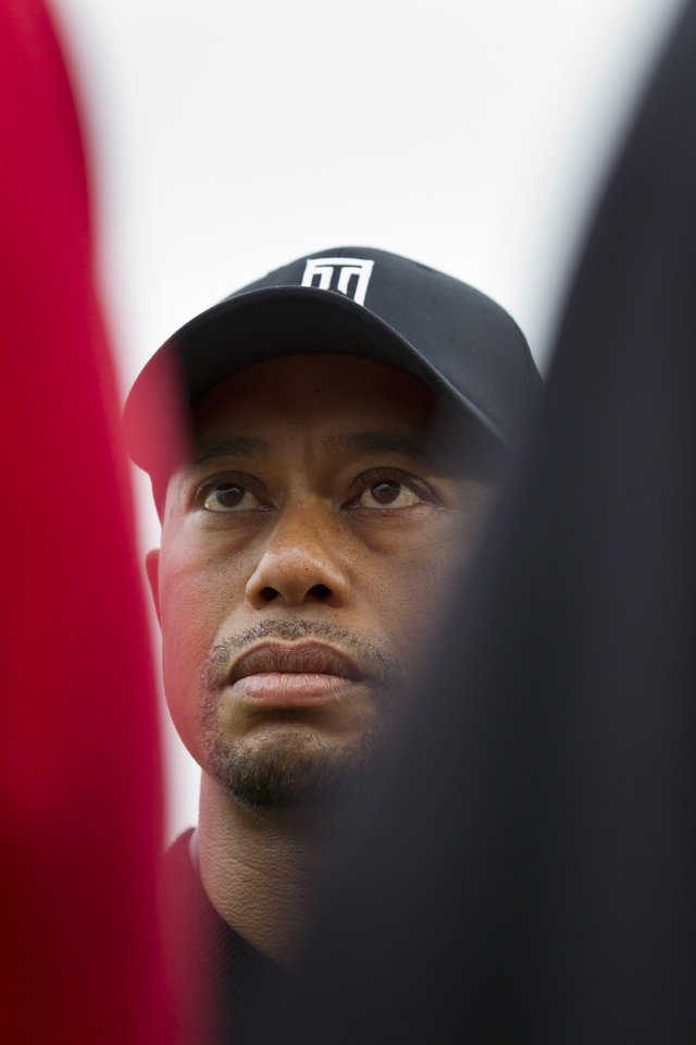 Photo - Tiger Woods of the US answers questions from reporters after a practice round at Royal Liverpool Golf Club prior to the start of the British Open Golf Championship, in Hoylake, England, Saturday, July 12, 2014. The 2014 Open Championship starts on Thursday July 17. (AP Photo/Jon Super)