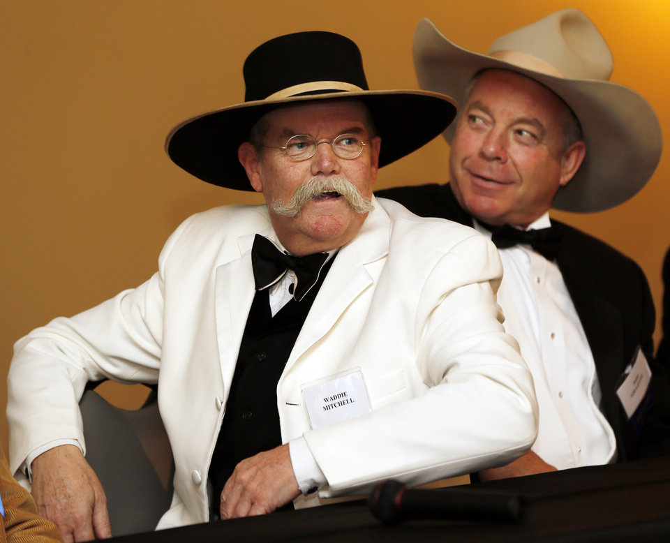 Photo - Waddie Mitchell, left, speaks next to Pipp Gillette during the press conference before the Western Heritage Awards at the National Cowboy & Western Heritage Museum in Oklahoma City, Saturday, April 20, 2013.
