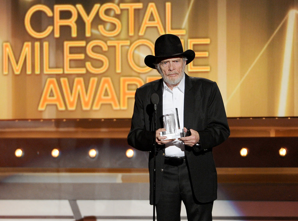 Photo - Merle Haggard accepts the crystal milestone award at the 49th annual Academy of Country Music Awards at the MGM Grand Garden Arena on Sunday, April 6, 2014, in Las Vegas. (Photo by Chris Pizzello/Invision/AP)