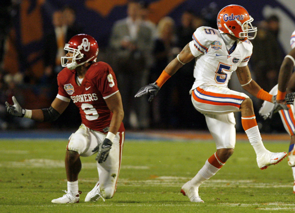 Photo - Florida's Joe Haden (5) celebrates after stoping Juaquin Iglesias (9) on a fourth down attempt late in the second half of the BCS National Championship college football game between the University of Oklahoma Sooners (OU) and the University of Florida Gators (UF) on Thursday, Jan. 8, 2009, at Dolphin Stadium in Miami Gardens, Fla. Oklahoma lost the game 24-14 to the Gators.