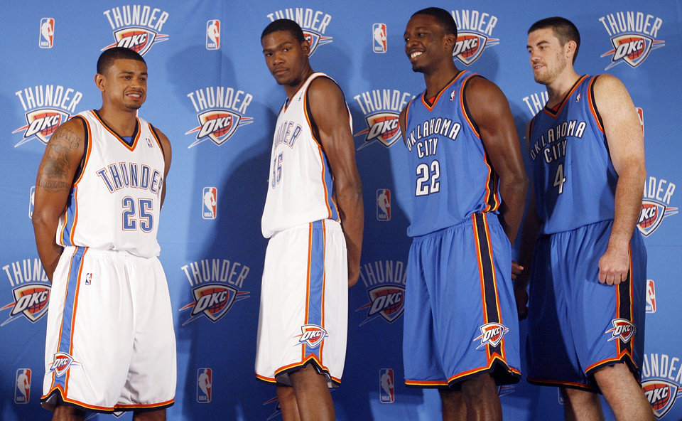 Photo - The Thunder's Earl Watson (25), Kevin Durant (35), Jeff Green (22), and Nick Collison (4) model the new team uniforms at the uniform unveiling during media day for the Oklahoma City Thunder NBA basketball team at the Skirvin Hilton hotel in Oklahoma City, Monday, September 29, 2008. BY NATE BILLINGS, THE OKLAHOMAN. ORG XMIT: KOD