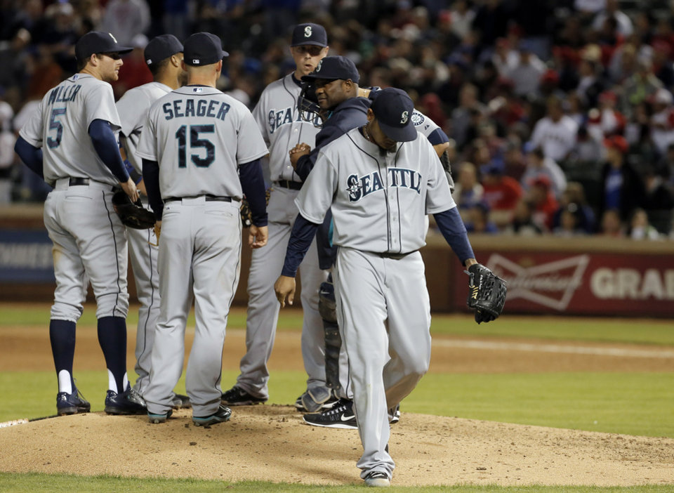 Photo - Seattle Mariners starting pitcher Felix Hernandez (34) walks to the dugout after being relieved during the eighth inning of a baseball game against the Texas Rangers, Wednesday, April 16, 2014, in Arlington, Texas. Texas won 3-2. (AP Photo/Brandon Wade)