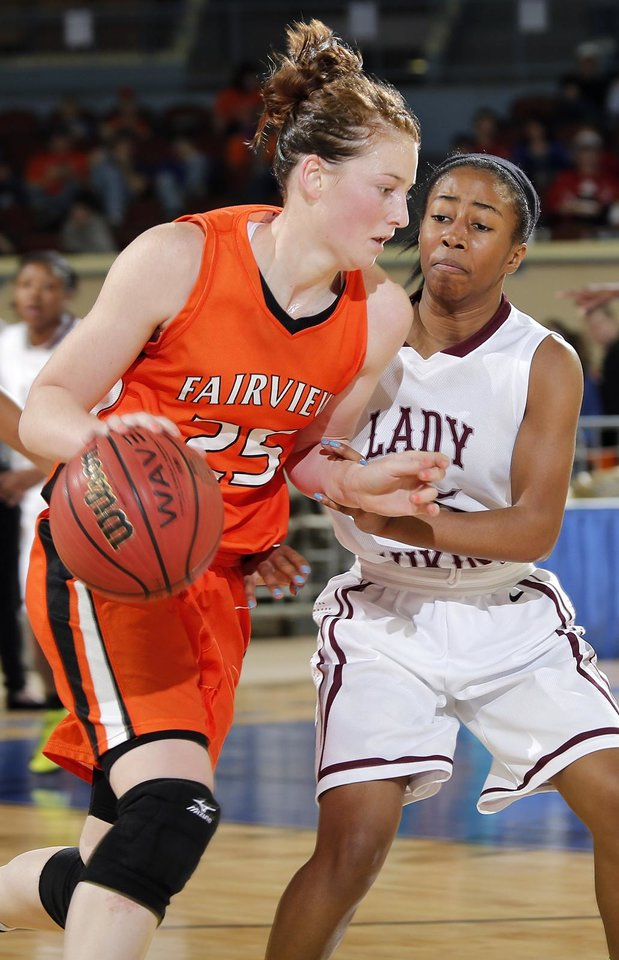 Photo - Northeast's Latia Robertson (15) defends Fairview's Olivia Mason (25) during the state high school basketball tournament Class 2A girls semifinal game between Fairview High School and Northeast High School at the State Fair Arena on Friday, March 8, 2013,, in Oklahoma City, Okla. Photo by Chris Landsberger, The Oklahoman