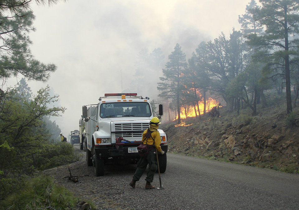 Photo -   Firefighters work an area along the northwest perimeter of a massive blaze in the Gila National Forest in New Mexico in this photo made on Monday, May 28, 2012, and provided by the U.S. Forest Service Friday. More than 1,200 firefighters are battling the fire that has burned nearly 217,000 acres in an isolated mountainous area of southwestern New Mexico. (AP Photo/U.S. Forest Service, John Roads)