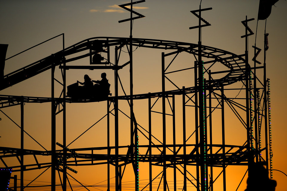 Visitors to the Oklahoma State Fair ride a roller coaster in Oklahoma City, Wednesday, Sept. 18, 2013. Photo by Bryan Terry, The Oklahoman