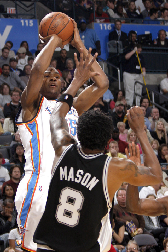Photo - Oklahoma CIty's Kevin Duran (35) shoots over San Antonio's Roger Mason (8) during the NBA game between Oklahoma City and San Antonio, Tuesday April 7, 2009, at the Ford Center in  Oklahoma CIty. Photo by Brenda O'Brian. The Oklahoman