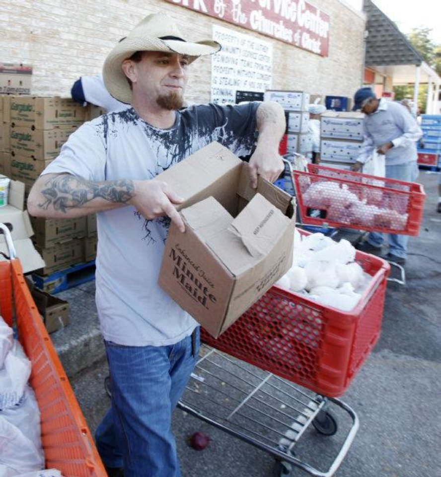 Photo - Volunteer Bryan North provides curbside grocery service to needy Luther families. PHOTO BY STEVE GOOCH, THE OKLAHOMAN  Steve Gooch - The Oklahoman
