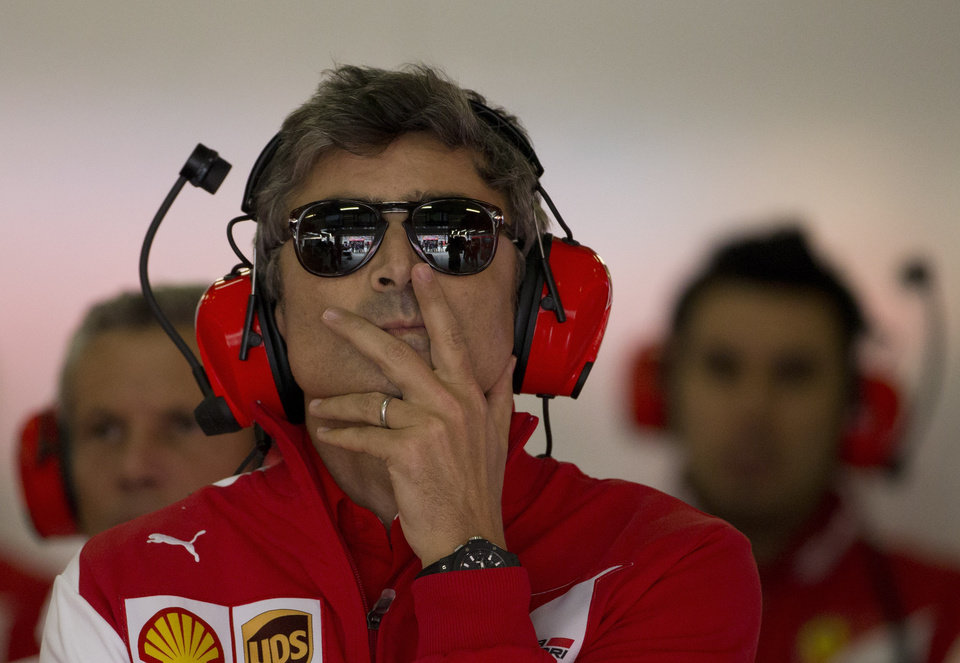 Photo - Ferrari's new team principal Marco Mattiacci, center, watches the monitor during the practice session ahead of Sunday's Chinese Formula One Grand Prix at Shanghai International Circuit in Shanghai, China Friday, April 18, 2014.  (AP Photo/Andy Wong)