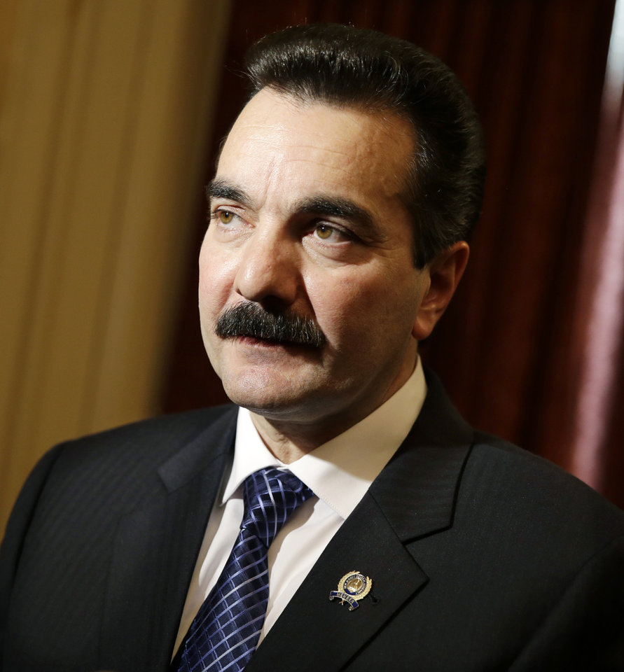 Photo - Incoming New Jersey Assembly Speaker Vincent Prieto, D-Secaucus, N.J., listens to a question Monday, Jan. 13, 2014, in Trenton, N.J., after the assembly announced a new special legislative committee will be tasked with finding out how high up New Jersey Gov. Chris Christie's chain of command a plot went that was linked through emails and text messages to a seemingly deliberate plan to create traffic gridlock in a town at the base of the George Washington Bridge after its mayor refused to endorse Christie for re-election. (AP Photo/Mel Evans)