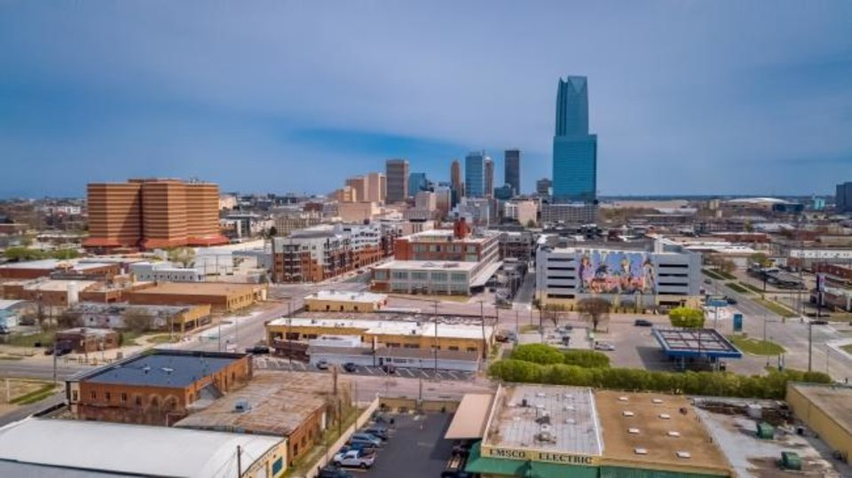 Photo -  Drone image of OKC skyline, looking east toward West Village (foreground). Oklahoma County jail is to the left. [Dave Morris/The Oklahoman]