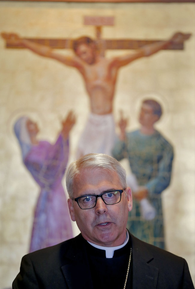 Photo - Archbishop Paul S. Coakley speaks during a news conference Monday at the Catholic Pastoral Center in Oklahoma City. Photo by Chris Landsberger, The Oklahoman  CHRIS LANDSBERGER - CHRIS LANDSBERGER
